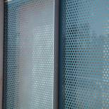 Frit-printed glass and the red glass fibre mesh of the auditorium.