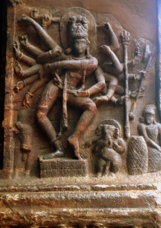 18-armed Dancing Shiva Sculpture situated at entrance of Cave no. 1 representing 18 Dance forms.