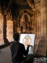 An artist sitting and trying to capture the sculpture through his painting.