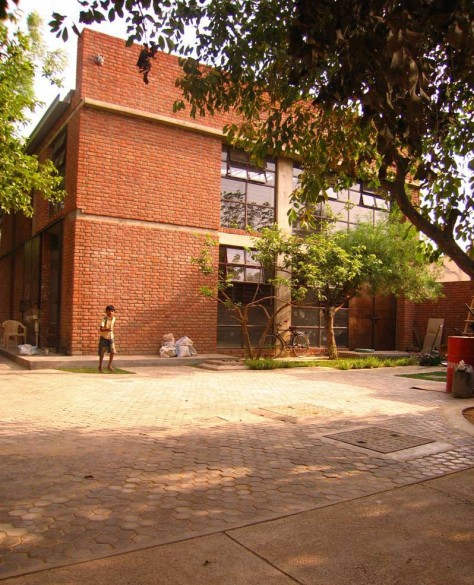 The road from the entrance widens into small court which houses the core services and ancillary spaces.