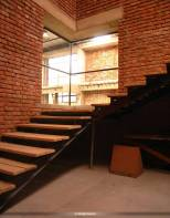 The staircase and viewing balcony which connects the showroom and factory space on the ground floor to the studio on the first level.