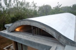 The vault filters in light and ventilation into the bedrooms and the kitchen.