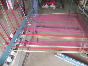 Inspiration derived from wrapping of threads around the loom.