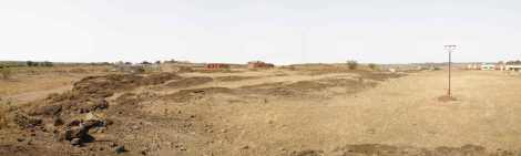 The vast expanse of the site, overlooking a sparse built-environment amidst the dusty terrains of Ahmednagar