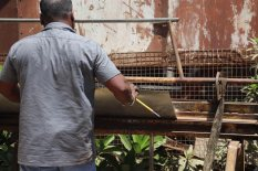 Using a special machine fabricated in Auroville, the metal sheets are folded into troughs