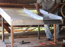 The insulation is laid out to receive the metal sheets when using non-corrugated aluminium sheets