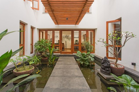 The courtyard and the interior landscape against a warm teak wood palette